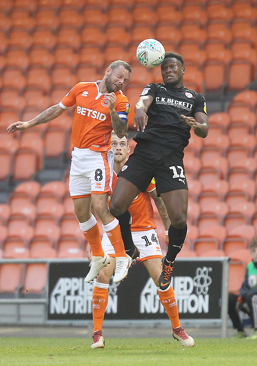 Blackpool's Jay Spearing  jumps with  Barnsley's Dimitri Cavaré<br /> <br /> Photographer Mick Walker/CameraSport<br /> <br /> Carabao Cup First Round - Blackpool v Barnsley - Tuesday August 14th 2018 - Bloomfield Road - Blackpool<br />  <br /> World Copyright © 2018 CameraSport. All rights reserved. 43 Linden Ave. Countesthorpe. Leicester. England. LE8 5PG - Tel: +44 (0) 116 277 4147 - admin@camerasport.com - www.camerasport.com