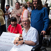 Protest of the association of disabled, outside the greek ministry of interior affairs in Stadiou Str. They are protesting because their living allowances have been lowered and back paid.