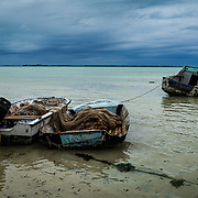 Small fishing boats showing signs of their age sit unused during the COVID-19 pandemic on Harbour Island, Bahamas