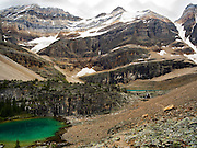 View of stunning Oesa Lake (background) and Lefroy Lake (left foreground) with  Glacier Peak in the background, in Yoho National Park, near Field, British Columbia, Canada