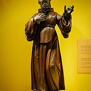 A statue of a monk in the museum in the Casa Santo Domingo hotel that is built amongst the ruins of a former monastery. Famous for its well-preserved Spanish baroque architecture as well as a number of ruins from earthquakes, Antigua Guatemala is a UNESCO World Heritage Site and former capital of Guatemala.
