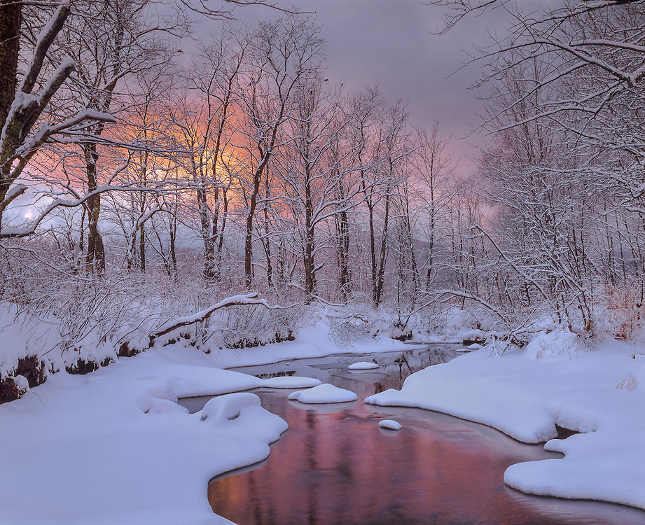 Whiteface River reflects snowcovered trees at dusk, Sandwich, NH