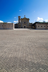 """Il Santuario è situato a circa cinque chilometri dal centro abitato, in aperta campagna, in origine era una chiesetta fondata dai monaci basiliani in un'area senza alcuna coltivazione che spiega l'appellativo """"alla macchia"""". Da oltre mezzo secolo rappresenta l'ideale centro religioso di tutto il Salento.."""