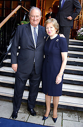 The EARL & COUNTESS OF CADOGAN at a garden party at the Goring Hotel, Beeston Palce, London SW1 to celebrate the unveiling of a bronze bust the late Queen Elizabeth the Queen Mother on 20th July 2004.
