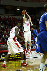 29 December 2010: Jon Ekey buries a 3 point shot during an NCAA basketball game where the Creighton Bluejays defeated the Illinois State Redbirds at Redbird Arena in Normal Illinois.