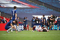 Football - 2020 Emirates 'Heads Up' FA Cup Final - Arsenal vs. Chelsea <br /> <br /> Dani Ceballos (A) and Ainsley Maitland-Niles (A) celebrate on the floor as Marcos Alonso (C) and Jorginho (C) look dejected at the final whistle, at Wembley Stadium.<br /> <br /> The match is being played behind closed doors because of the current COVID-19 Coronavirus pandemic, and government social distancing/lockdown restrictions.