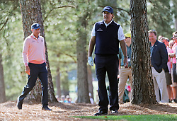 April 6, 2018 - Augusta, GA, USA - Matt Kuchar, left, and Phil Mickelson in the woods off of the first fairway where they both hit their drives during the second round of the Masters at Augusta National Golf Club on Friday, April 6, 2018, in Augusta, Ga. (Credit Image: © Jason Getz/TNS via ZUMA Wire)