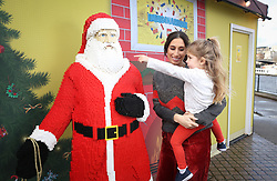 EDITORIAL USE ONLY<br /> Stacey Solomon with her niece Mila Brent (3) and a model of Santa Claus at the LEGO Imaginarium, which is open for this weekend only on London's Southbank.
