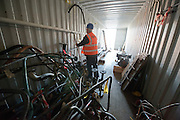 ****COPY HERE****  (https://www.dropbox.com/s/5mg81qiiuy22tre/adamson.rtf?dl=0)   © Licensed to London News Pictures. 02/12/2014. Liverpool , UK . Volunteer Graham Dean works in the a storage container at the workshop. The only surviving steam powered tug tender, the Daniel Adamson, is being completely renovated by a team of volunteers in Liverpool. The vessel, which has had 90,000 man hours already spent on it, was bought for only one pound is the awaiting the decision of the Heritage LotteryFund on an application of £3.6m to bring her back to her full glory.  . Photo credit : Stephen Simpson/LNP<br /> <br /> COPY HERE https://www.dropbox.com/s/5mg81qiiuy22tre/adamson.rtf?dl=0