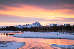 """Sunset of the Gand Tetons as the light of the sky is sucked up like a magnet by the Snake River below.<br /> <br /> For production prints or stock photos click the Purchase Print/License Photo Button in upper Right; for Fine Art """"Custom Prints"""" contact Daryl - 208-709-3250 or dh@greater-yellowstone.com"""