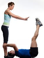 couple,man and woman doing abdominals workout push ups posture on studio  isolated white background