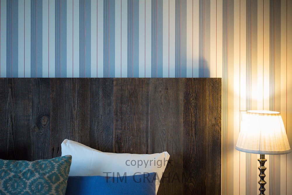 Typical Danish minimalist design hotel room with headboard of wooden planks in Denmark