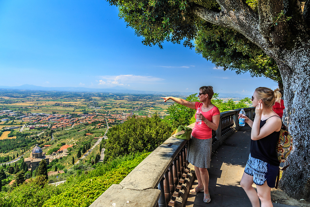 Tourist admire scenary in Cortona, Italy. Cortona situates on the Monte Egidio at an elevation of 600 meters (2,000 ft) that embraces a view of the whole of the Valdichiana.