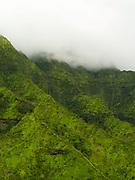 Aerial view of a waterfall, Kauai, Hawaii on a cloudy day.
