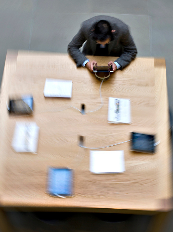 A men is testing the iPad, at the Apple store in Covent Garden, London. The release of the iPad II takes place on Friday at 5 pm, and will replace the earlier version.  (AP Photo/Bogdan Maran)