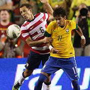 Neymar, Brazil, (right) challenges Steve Cherundolo, USA, during the USA V Brazil International friendly soccer match at FedEx Field, Washington DC, USA. 30th May 2012. Photo Tim Clayton