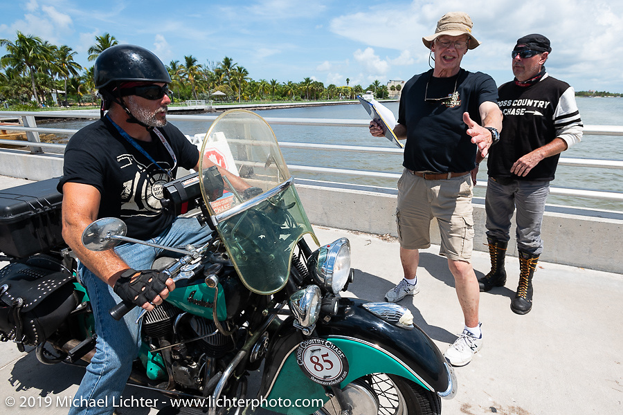 Jason Wadzinski on Jess, his 1947 Indian Chief, at a staging area before the finish of the Cross Country Chase motorcycle endurance run from Sault Sainte Marie, MI to Key West, FL. (for vintage bikes from 1930-1948). The staging area on a Key West pier just before the finish and near the end of the 110 mile Stage-10 ride from Miami to Key West, FL USA. Sunday, September 15, 2019. Photography ©2019 Michael Lichter.