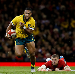 Samu Kerevi of Australia evades the tackle of Hadleigh Parkes of Wales<br /> <br /> Photographer Simon King/Replay Images<br /> <br /> Under Armour Series - Wales v Australia - Saturday 10th November 2018 - Principality Stadium - Cardiff<br /> <br /> World Copyright © Replay Images . All rights reserved. info@replayimages.co.uk - http://replayimages.co.uk