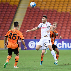 BRISBANE, AUSTRALIA - FEBRUARY 21: Xisco Jimenez of Muangthong United heads the ball infant of Jacob Pepper of the Roar during the Asian Champions League Group Stage match between the Brisbane Roar and Muangthong United FC at Suncorp Stadium on February 21, 2017 in Brisbane, Australia. (Photo by Patrick Kearney/Brisbane Roar)