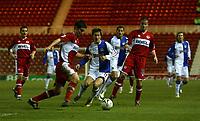 Photo: Andrew Unwin.<br /> Middlesbrough v Blackburn Rovers. Carling Cup. 21/12/2005.<br /> Blackburn's Morten Gamst Pedersen (C) looks to challenge Middlesbrough's Chris Riggott (L).