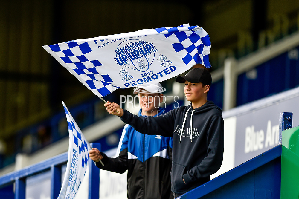 Young Portsmouth fans wave promotion 2017 flags during the EFL Sky Bet League 2 match between Portsmouth and Cambridge United at Fratton Park, Portsmouth, England on 22 April 2017. Photo by Adam Rivers.