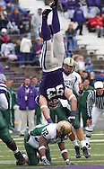 Kansas State defensive end Scott Edmonds #93 blocks the Baylor pass with his right leg as he is upended by Baylor's Rashad Armstrong #32 during the second quarter at KSU Stadium in Manhattan, Kansas Saturday, Nov. 1, 2003.  Kansas State defeated Baylor 38-to-10.  <br />