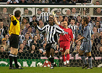 Photo. Glyn Thomas.Digitalsport<br /> Newcastle United v Olympique de Marseille. <br /> UEFA Cup Semi Final, First Leg. 22/04/2004.<br /> Newcastle's Shola Ameobi (second from L) protests as referee Ivanov Valentin (L) rules his first half goal offside.