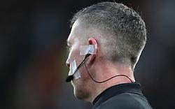 Match Referee Andy Davies wears a headset