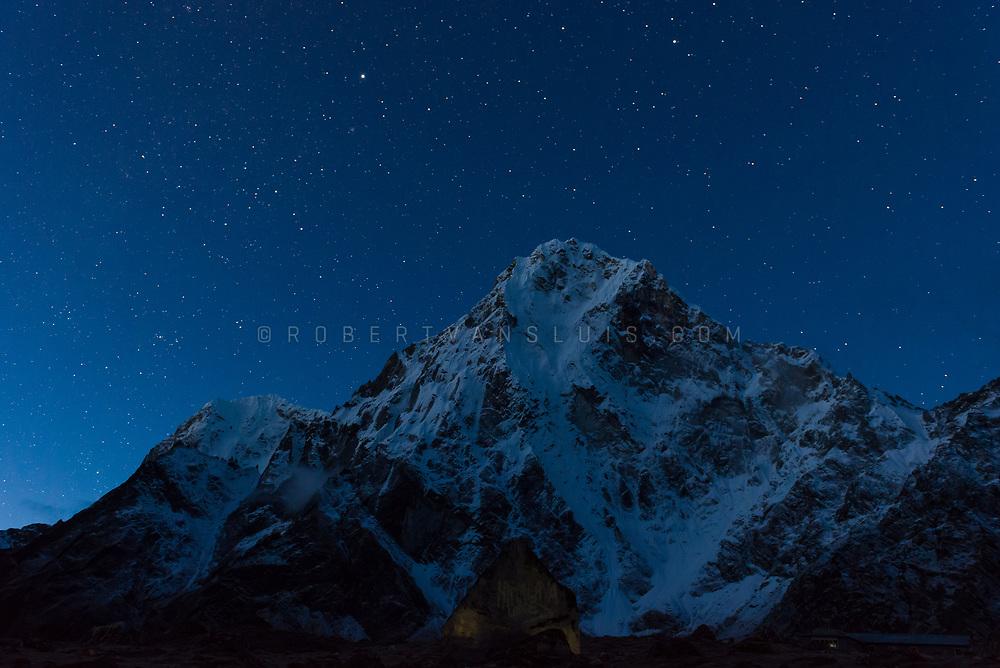 Stars over Arakam Tse (6423 m) in the Nepal Himalaya. Photo © robertvansluis.com