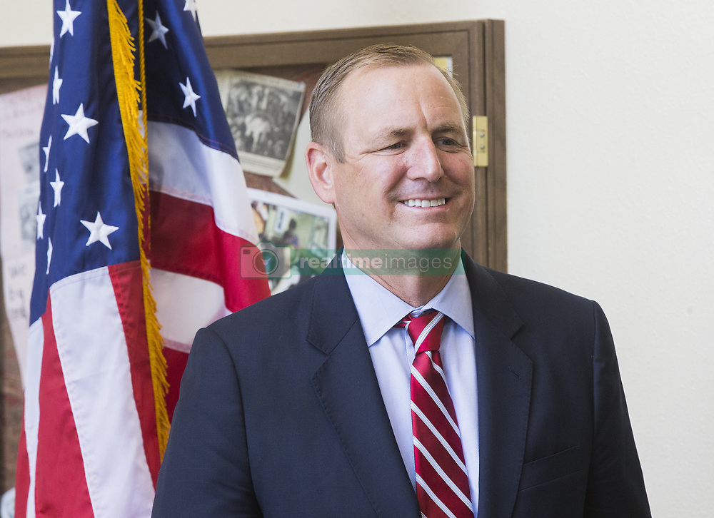 July 31, 2018 - Ceres, CA, USA - Congressman Jeff Denham waits to take photos with new U.S. citizens during a Naturalization Ceremony at the Ceres Community Center on Tuesday, July 31, 2018. (Credit Image: © Marty Bicek/TNS via ZUMA Wire)