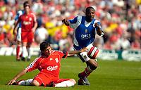 Photo: Ed Godden.<br /> Portsmouth v Liverpool. The Barclays Premiership. 28/04/2007. Portsmouth's Lauren (R), beats Emilano Insua to the ball.