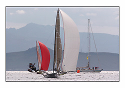 The 2004 Skiff Nationals at Largs held by the SSI.<br /> <br /> Andy Richards, Andy Fairlie and Dave Richards onboard Radii. With Drum<br /> <br /> Marc Turner / PFM Pictures