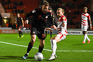 Aidan McGeady of Sunderland (19) and Alfie May of Doncaster Rovers (19) during the EFL Sky Bet League 1 match between Doncaster Rovers and Sunderland at the Keepmoat Stadium, Doncaster, England on 23 October 2018.