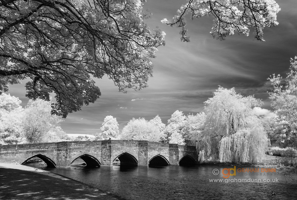 Bakewell's famous 13th Century, 5-arched bridge as it spans the River Wye in Derbyshire. Infrared capture and monochrome conversion. Peak District National Park, England, UK. Spring, 2014.
