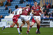 Louis Senior (24) of Huddersfield Giants is tackled by Bevan French (6) of Wigan Warriors during the Betfred Super League match between Huddersfield Giants and Wigan Warriors at the John Smiths Stadium, Huddersfield, England on 1 March 2020.