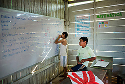 NO WEB/NO APPS - Exclusive. (Text available) Secondary school students ('Escuela Segundaria') are trying to solve a mathematical problem, in 'Palma Real' native community, near Puerto Maldonado, Peru on July 17, 2017. The Amazon rainforest is famous as 'The Lung of the Earth', but also for the presence of numerous native communities, who have always lived isolated and in close contact with nature for generations, used to seek for food and medicines and to build items directly from the environment in which they live. The unstoppable rise of globalization has drastically changed their needs, expectations and consequently their way of life. Located in the Tambopata National Reserve, on the border between Peru and Bolivia, the native Comunidad Palma Real is one of the clearest examples of this change. Living on the banks of the Madre de Dios River since approximately 1976, Palma Real comprises about 300 people part of the nomadic community Ese-Eja, established in the Amazon rainforest of Peru before the Spanish colonization. Photo by Giacomo d'Orlando/ABACAPRESS.COM