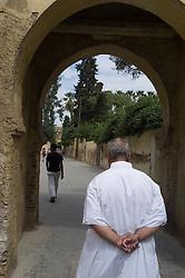 People walking through alleys of Fes al Bali medina, Fes, Morocco