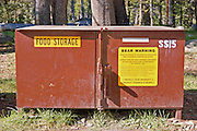 Sign warning of bear habitat on food locker, Tuolumne Meadows, Yosemite National Park, California