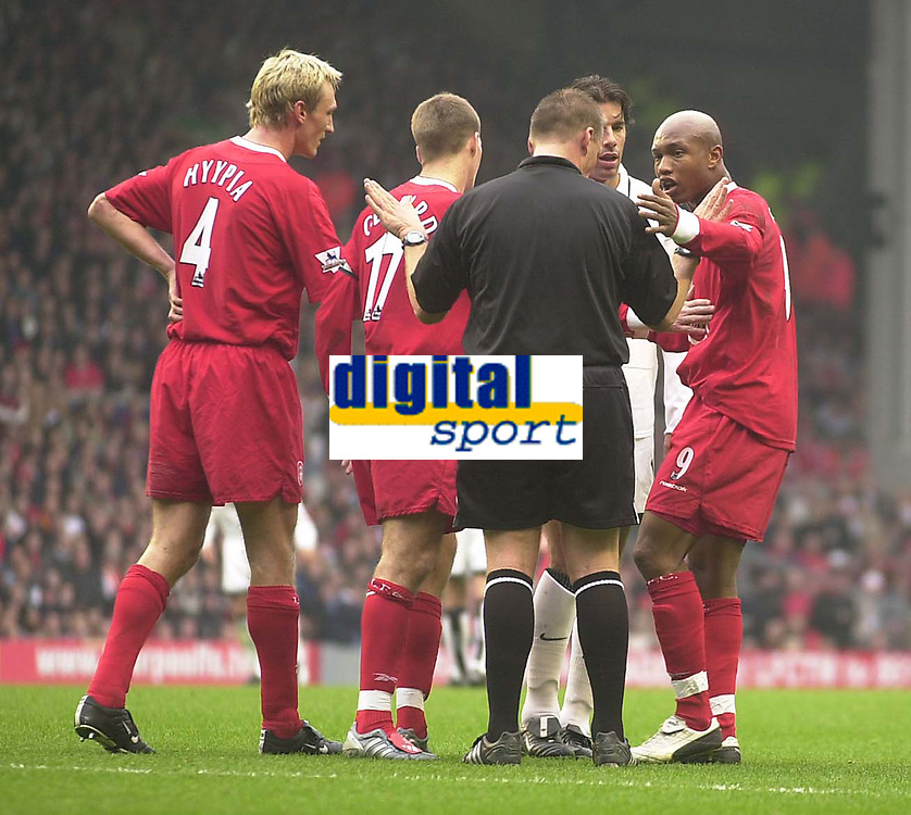 Photo. Glyn Thomas.<br /> Liverpool v Manchester United. Barclaycard Premiership.<br /> Anfield, Liverpool. 09/11/03.<br /> Manchester United's Ruud van Nistelrooy (L) is less than happy at being shown a yellow card and a confrontation ensues involving Liverpool's El-Hadji Diouf (R).