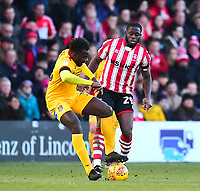 Lincoln City's John Akinde vies for possession with Northampton Town's Aaron Pierre<br /> <br /> Photographer Andrew Vaughan/CameraSport<br /> <br /> The EFL Sky Bet League Two - Lincoln City v Northampton Town - Saturday 9th February 2019 - Sincil Bank - Lincoln<br /> <br /> World Copyright © 2019 CameraSport. All rights reserved. 43 Linden Ave. Countesthorpe. Leicester. England. LE8 5PG - Tel: +44 (0) 116 277 4147 - admin@camerasport.com - www.camerasport.com