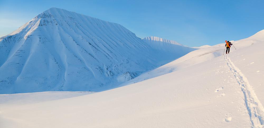 Mylène Jacquemart skins up a hillside in Koslådalen, Svalbard.