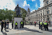 Police stand guard around Winston Churchill statue in Parliament Square in central London, on Saturday, June 20, 2020, ahead of a protest organised by Black Lives Matter. <br /> Monuments have become major focuses of contention in demonstrations against racism and police violence. Anger against systemic levels of institutional racism has raged through the city, and worldwide; sparked following the death of George Floyd in the United States last month. Demonstrations are taking place this Saturday in cities including London, Manchester, Edinburgh and Glasgow. (Photo/ Vudi Xhymshiti)