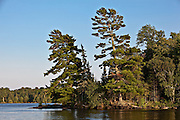 Island in Voyageurs National Park on Lake Kabetogama Minnesota. Voyager National Park is in the Border Lakes region of northern Minnesota and northwestern Ontario. This forested, lake-filled landscape covers 5.1 million acres surrounding Quetico Provincial Park, Voyageurs National Park and the Boundary Waters Canoe Area Wilderness. This region is part of the Superior National Forest in northeastern Minnesota.