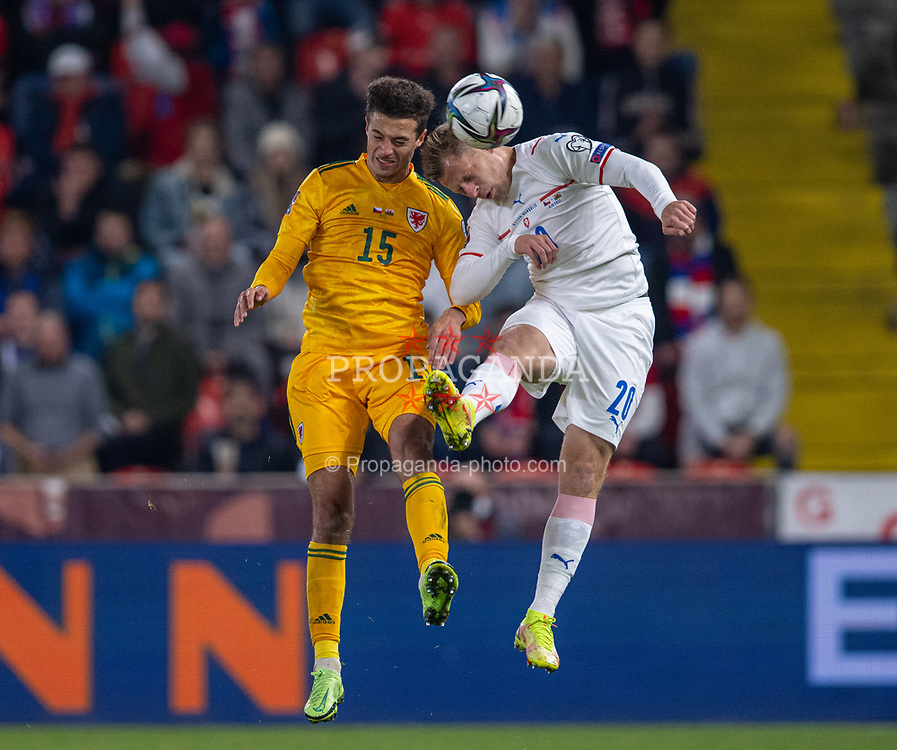 PRAGUE, CZECH REPUBLIC - Friday, October 8, 2021: Wales' Ethan Ampadu (L) challenges for a header with Czech Republic's substitute Matěj Vydra during the FIFA World Cup Qatar 2022 Qualifying Group E match between Czech Republic and Wales at the Sinobo Stadium. The game ended in a 2-2 draw. (Pic by David Rawcliffe/Propaganda)