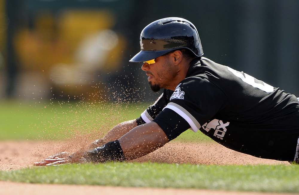 GLENDALE, ARIZONA - MARCH 4:  Jacob May #64 of the Chicago White Sox slides head first into second base with a double during the spring training game against the Los Angeles Angels of Anaheim on March 4, 2017 at Camelback Ranch in Glendale Arizona.  (Photo by Ron Vesely)   Subject:  Jacob May