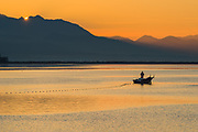 Fisherman at sunset, October, near the mouth of the Dungeness River, North Olympic Peninsula, Washington, USA
