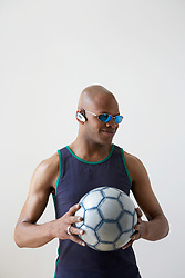 Dec. 13, 2012 - Man with soccer ball and headset (Credit Image: © Image Source/ZUMAPRESS.com)