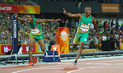 South Africa's Akani Simbine celebrates winning gold in the Men's 100m Final as South Africa's Henricho Bruintjies (left) takes silver at the Carrara Stadium during day five of the 2018 Commonwealth Games in the Gold Coast, Australia.