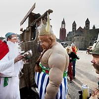 Nederland, Maastricht , 10 februari 2013..Carnaval in de straten van Maastricht..Op de foto: carnaval vierders op het Vrijthof uitgedost als figuren Obelix en de anderen uit de stripverhaal Asterix..Carnival in the streets of Maastricht.