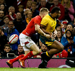Gareth Anscombe of Wales strips the ball from Samu Kerevi of Australia<br /> <br /> Photographer Simon King/Replay Images<br /> <br /> Under Armour Series - Wales v Australia - Saturday 10th November 2018 - Principality Stadium - Cardiff<br /> <br /> World Copyright © Replay Images . All rights reserved. info@replayimages.co.uk - http://replayimages.co.uk